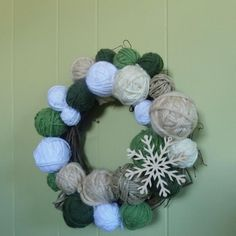 If your walls are looking a little plain, then spruce them up this holiday season by hanging a Yarn DIY Christmas Wreath.