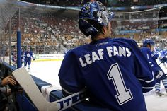 """Curtis Joseph #31 of the Toronto Maple Leafs wears a ""Leaf Fans #1"" jersey during warmup prior to facing the Buffalo Sabres in a preseason NHL game at the Air Canada Centre September 22, 2008 in Toronto, Ontario. The jerseys were later given to fans in attendance."" Hockey Rules, Hockey Teams, Air Canada Centre, Nhl Games, Florida Panthers, Columbus Blue Jackets, New York Islanders, Boston Bruins, Ottawa"