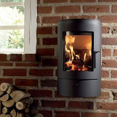 The Westfire Uniq 21 Wall Hung Wood Burning Stove is compact in size and its low output makes it ideal for smaller rooms. Primary air, secondary air and tertiary air supplies give the Westfire Uniq 21 woodburner an efficiency of over The rounded g Small Wood Burning Stove, Solid Fuel Stove, Wooden Wall Design, Wooden Walls, Wall Wood, High Efficiency Wood Stove, Inset Stoves, Wood Stoves, Contemporary Wood Burning Stoves