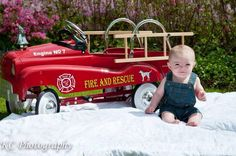 Baby picture by old fire truck ride on toy