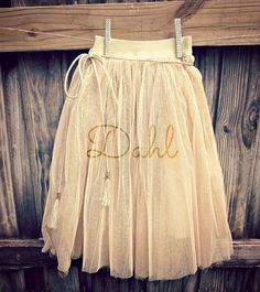 Our golden tea time skirt is made with gold tulle and gold glitter netting layers that gives the appearance of a pixie dust skirt.  The waistband is made of golden elastic, and stretches up to 4inches, this skirt will grow with your child, can be worn as a maxi skirt, tea length , and then tutu...