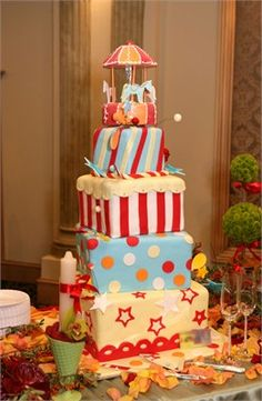 Red blue white and yellow carnival themed wedding Cake