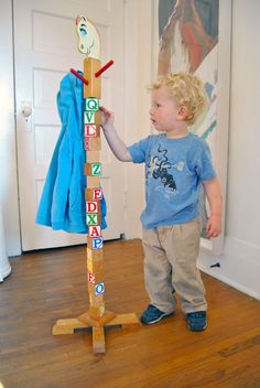 DIY kids coat rack- seriously SOO cute, id like it better if it were all painted brown and get rid of the horse head on top lol