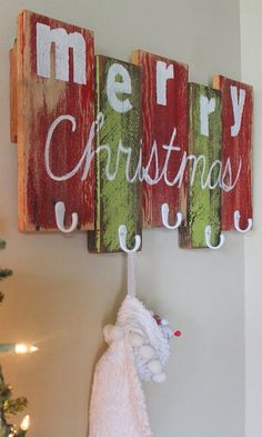 Rustic holiday stocking holder.  I want to make this!!!
