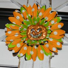 Check out this item in my Etsy shop https://www.etsy.com/listing/468389750/pumpkin-daisy-hair-clip