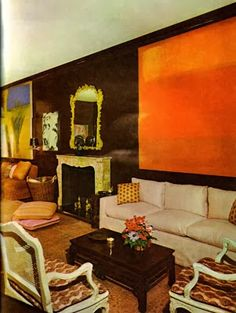 An orange abstract painting sets the tone in a monochromatic living room decorated by Billy Baldwin. From Billy Baldwin Decorates.
