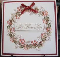 Stamped the Card-io twig stamps over a pencilled circle on ivory cardstock, then added the tapestry stamps with distress inks. Sentiment is Penny Black. Stickles added to the flower centres. TFL