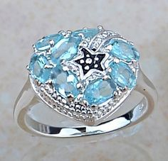 SOLD!  Fire Blue Topaz and Silver ring