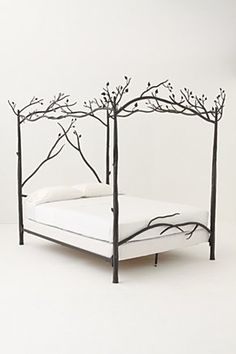 I'm obsessed with this bed by anthroplogie.  Seriousely thinking about getting a part time job somewhere just to pay for it!