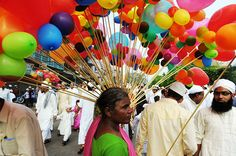 An Indian street vendor sells balloons to Muslim faithful after Eid al-Fitr prayers near the Jama Masjid Mosque in the old quarters of New Delhi /