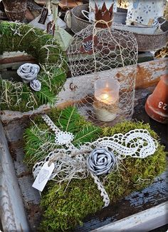 I like the idea of covering bits of cardboard and styrofoam with moss and wrapping them in lace like gifts.