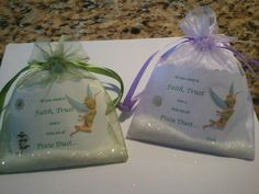 Pixie Dust Bags for a Tinkerbell Birthday Party.  Small wedding favor bags, White Tinkerbell Birthday--Glitter, Plain white paper and Tinkerbell scrapbook stickers.  It only cost me five dollars to make 10.