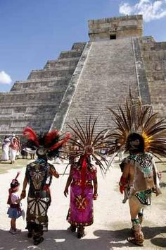 Mayan gather in front of the Kukulkan Pyramid in Chichen Itza, Mexico. A Mexican Indian seer who calls himself Ac Tah, and who has traveled around Mexico erecting small pyramids he calls
