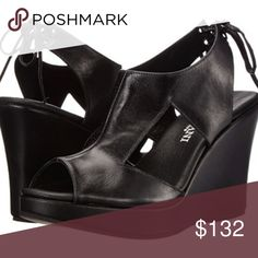 Cordani Wilder Platform Wedge - Black Leather Show off your Wilder side in these chic wedges from Cordani! - Leather upper with cutouts at vamp - Lace-up closure at heel panel - Peep-toe silhouette - Leather lining - Heel Height 4 inches; 1 inch platform Cordani Shoes