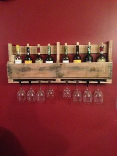 a DIY wine rack made from pallets adds a nice touch to your home and a handy place to store your wine!