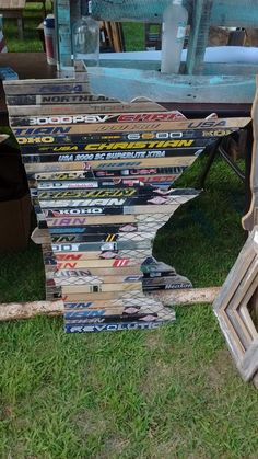 Small and large sign made out of hockey sticks