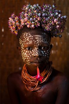 Africa | A Karo child that loves flowers.  Omo Valley,  Ethiopia | ©Eric Lafforgue