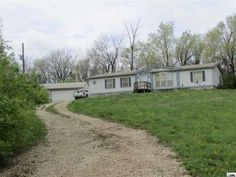 For Sale 11701 S Vawter Rd Carbondale, KS $90,000 3 Acres 3 Bed 2 Bath 3BR, 2ba, 1996 dblewide in good condition on 3 ac m/l, 1680 fin sq ft, 30 x 24 metal garage w/cement flr, has propane stove but no insulation, a lot of mechanical tools can be purchased from seller.  Beds 3 Bed Baths 2 Full Bath House Size 1,686 Sq Ft Year Built 1996  Contact me for a showing or for more information Brandy Criss Engler (785)383-3169 bbmcriss@yahoo.com Liberty Real Estate