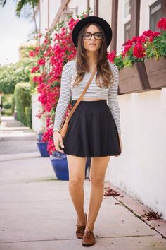 Opt for comfort in a white and black striped cropped sweater and a black skater skirt. Brown leather oxford shoes will instantly smarten up even the laziest of looks.   Shop this look on Lookastic: https://lookastic.com/women/looks/cropped-sweater-skater-skirt-oxford-shoes-crossbody-bag-hat/12343   — Black Wool Hat  — White and Black Horizontal Striped Cropped Sweater  — Tan Leather Crossbody Bag  — Black Skater Skirt  — Brown Leather Oxford Shoes