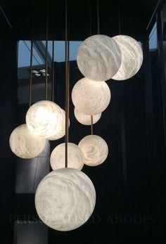 Atelier Alain Ellouz - the Harmonie 10 chandelier brings space down to earth with ten alabaster spheres