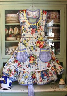 Vintage apron in old fashioned material with fun round gingham pockets. From www.stitchthrutime.com
