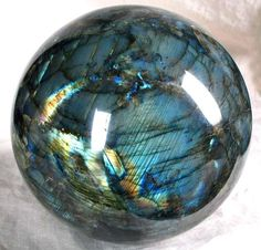 This is a beautiful ball, Spectrolite or Labradorite! It is my understanding that Labradorite comes from Labrador and the same material from elsewhere on the planet is Spectrolite. Names are given by humans so perhaps it only matters to them. Minerals And Gemstones, Crystals Minerals, Rocks And Minerals, Stones And Crystals, Gem Stones, Healing Crystals, Labradorite, Beautiful Rocks, Mineral Stone