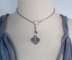 DIY Charm Necklace. Love this - add as many or few charms as you want to switch it up. Tutorial from Wobi Sobi here.