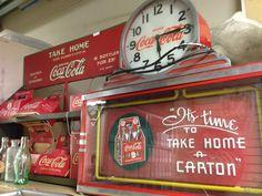 Coca-Cola clock and collectibles.