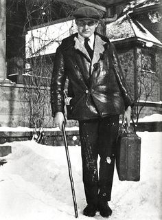 Ernest Hemingway leaving for Toronto, bottle of wine tucked into coatpocket, 1920.