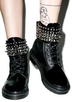 Demonia Phantom Ankle Boots are gonna haunt ya if ya don't snag yer self a pair. These badass boots are constructed from pebbled vegan leather with patent rounded toes. Featuring a sik studded cuff that can be completely removed making these bb's unique and versatile compete with lace up closure.
