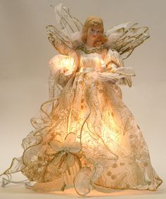 Angel tree topper.  I have one like this that sits on our end table. her wings change color