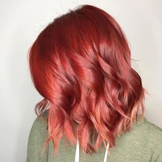 Forgive the pun, but this short true red bob by Aveda Artist Dwayne Tran has us seeing red. Literally.