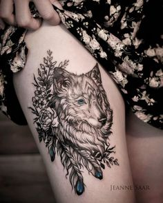 intricate wolf + floral thigh tattoo