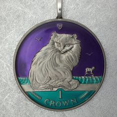 Turkish cat coin pendant.  Animalcoin.com.  Etsy listing at https://www.etsy.com/listing/179680479/isle-of-man-turkish-cat-coin-pendant