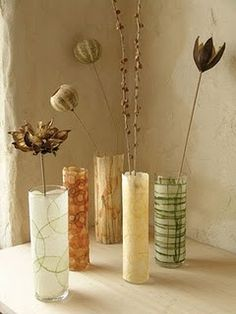 Paper Vases...I love this idea.  My sister has so many of these style vases left over from her wedding.  I am totally gong to make some of these.  The options are endless!