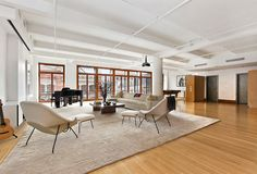 561 Broadway, Apt. 7AB, Soho/Nolita, Manhattan: Rare 5,000 sq. ft. full-floor loft in the Singer Building, a historic cast-iron Beaux Arts building in the heart of SoHo. This vast loft -- offering massive proportions with luxurious finishes -- is rich in pre-war and historic details. The private key-lock elevators opens into a 50-foot wide double-living room with mahogany-framed glass doors and a superb 19th Century wrought iron balcony.