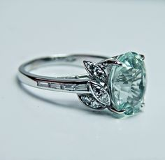 I LOVE this ring!  It has an aquamarine in it, which I would love in my wedding ring <3