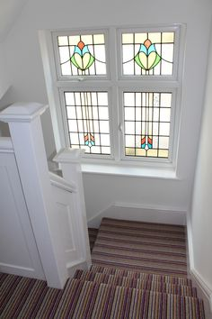 1930s stained glass window. Crucial Trading stripy carpet.