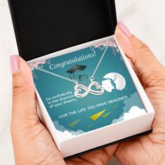 Are you looking to tell your graduate how much you love her and how proud you are of her accomplishments. This beautiful message card heart necklace can help you let her know how special she is to you. The necklace is available in gold and silver. The message card says: go confidently in the direction of your dreams. Live the life you have imagined. #graduationnecklace #highschoolgraduationgift #girlgraduationgift Infinity Heart, Infinity Symbol, High School Graduation Gifts, Graduation Necklace, Love Lily, Congratulations Graduate, Message Card, Working Moms, Lobster Clasp