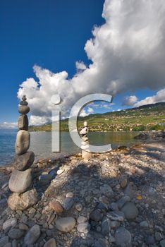 iPHOTOS.com - Stock Photo of Towers of Stones on a Beach #photos #photography #landscape