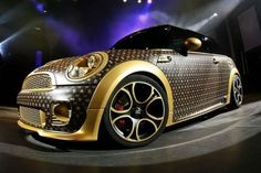 Mini Cooper Draped in Louis Vuitton Attire by German Tuning Company -  CoverEFX from Erftstadt Fahrzeugfolierer is a German tuning company that came up with this mind-blogging car by bringing together black leather with gold metallic on this Mini Cooper.  The all-in-leather car has gold imprints glued individually by hand to vividly bring out the signature Louis Vuitton feel with the foil embossing technique.