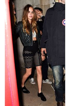 Cara Delevingne - Cara's cool cut-out skirt left little to the imagination—the supermodel covered up on top with a cropped leather bomber jacket.