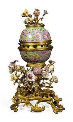 A Louis XV style gilt-bronze mounted Chinese porcelain famille rose pot-pourri vase the porcelain 18th/19th century, the mounts 19th century on a shaped bronze base 33cm. high
