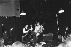The Rolling Stones performing at Parr Hall in 1963 - Brian & Bill at the front of stage, and Charlie (right).
