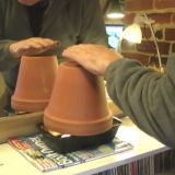 Heat a room very cheap with clay pots and tea lights. If you use bricks for the base instead of a bread pan, you will have a wider, sturdier base. Which means you don't have to worry about accidental tip overs as much.