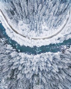 Picture of the day for January 08 2017 at 10:04PM from 'Daily Overview;  Check out this incredible drone shot of the Mountain Loop Highway in Washington USA cutting through the snow covered trees. Photograph by Michael Matti. Hope everyone is having a fantastic weekend!  Learn more about our new book here: http://amzn.to/2aND71C