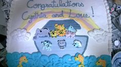 Noah's Ark Baby Shower Cakes - First of two baby shower cakes I made for a friend.This is a vanilla cake with a banana filling; covered in whipped frosting.
