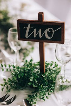 Rustic wedding chalk board table number   Raconteur Photography
