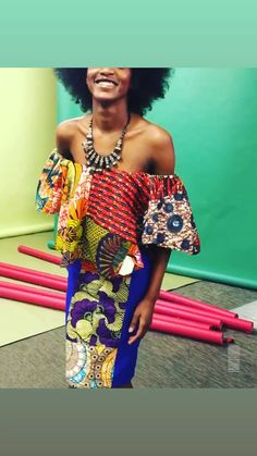 Off shoulder Bodycon African print dress with orange Ankara fabrics and stretch fabric at side Africa attire, Africa fashion, African attire. African Wear Dresses, Latest African Fashion Dresses, African Print Fashion, Africa Fashion, African Attire, African Prints, Ankara Fashion, African Fabric, Modern African Print Dresses