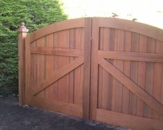 Simple arched driveway gate.  The framing makes it look substantial, especially the width of the frame along the arch.